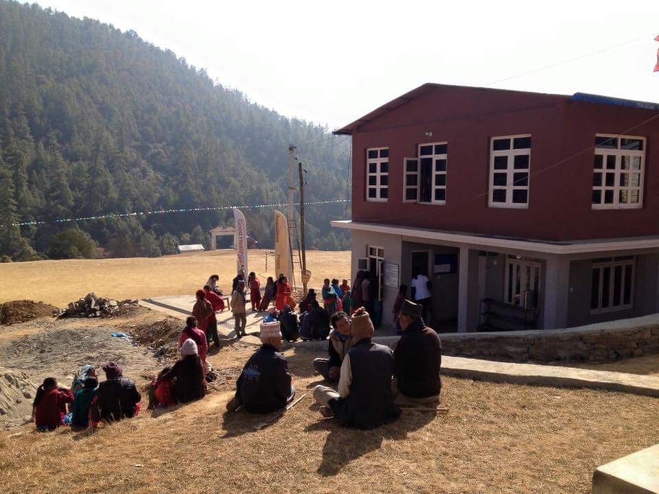 A photo of patients waiting outside the clinic