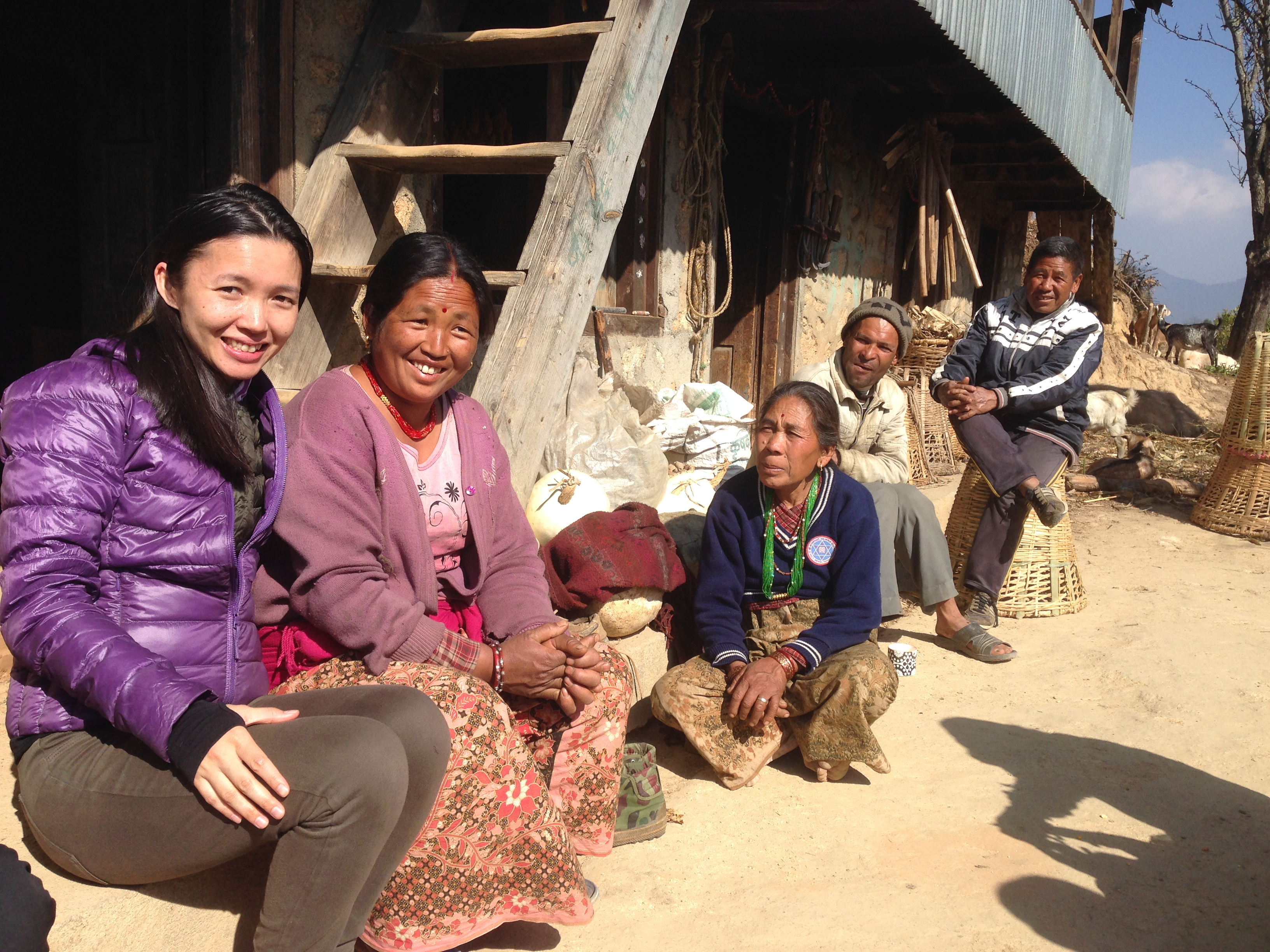Photo of Rachel and a group of villagers