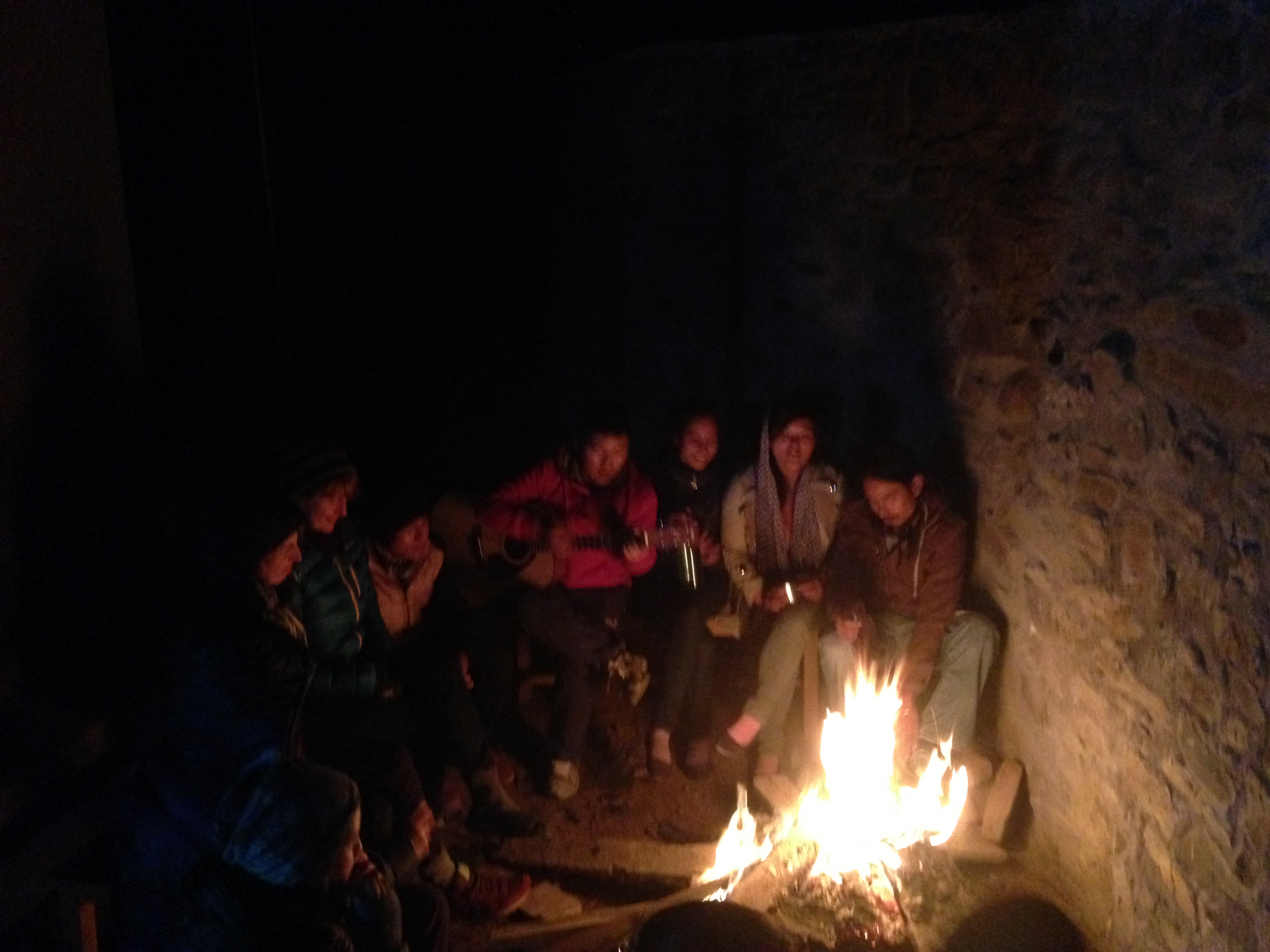 A photo of the locals singing folk songs around a campfire